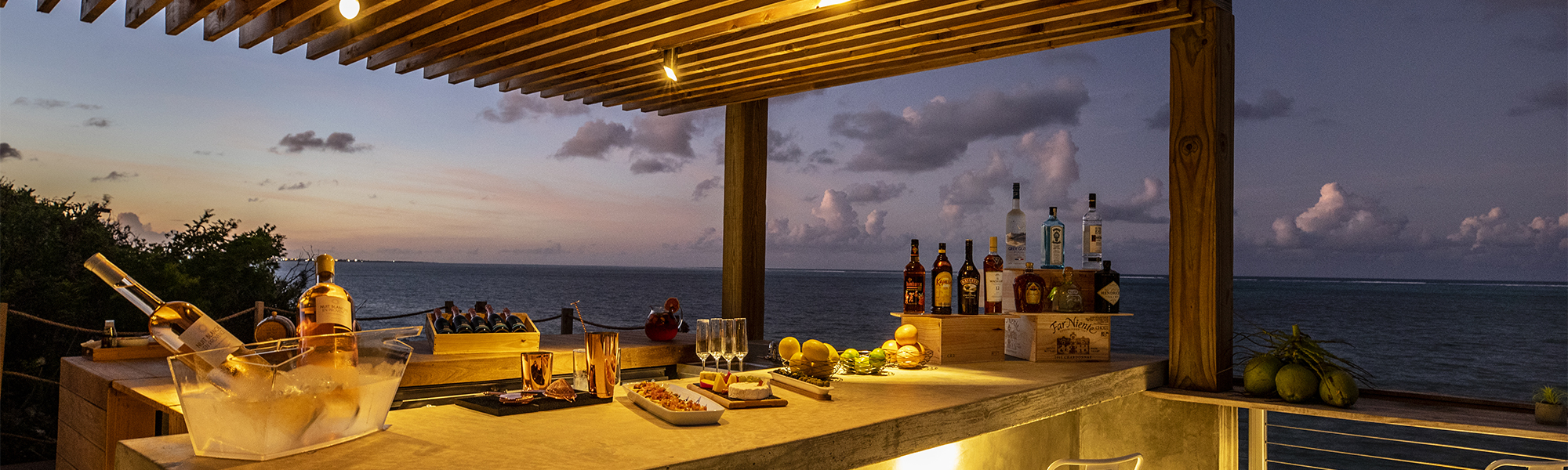 Food and drinks on a beachside bar at dusk